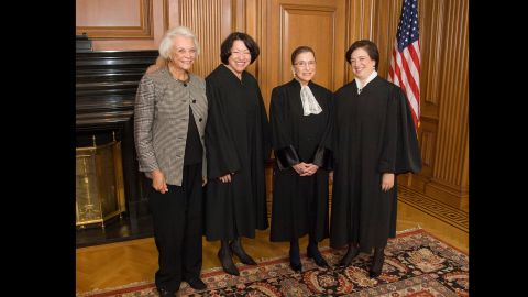 """The only women who have become Supreme Court justices pose in the Justices' Conference Room on October 1, 2010, the day of Justice Elena Kagan's investiture. Standing, from left to right, are retired Justice Sandra Day O'Connor and Justices Sonia Sotomayor, Ruth Bader Ginsburg and Elena Kagan. These images are part of a collection from the book """"My Own Words"""" by Ruth Bader Ginsburg with Mary Hartnett and Wendy W. Williams, published by Simon & Schuster."""