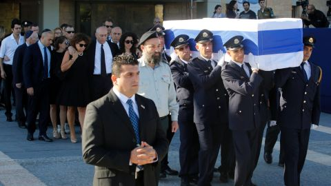 Members of the Knesset guard carry the coffin of former Israeli prime minister Shimon Peres.