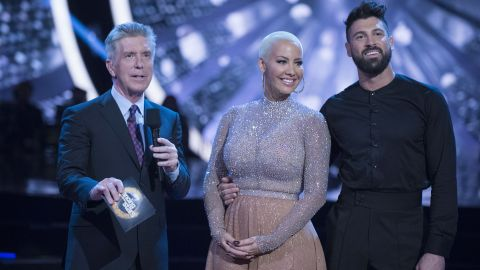 """""""Dancing with the Stars"""" contestant Amber Rose said she felt body shamed by judge Julianne Hough during her week 3 performance. Rose is shown here with co-host Tom Bergeron and partner Maksim Chmerkovskiy."""