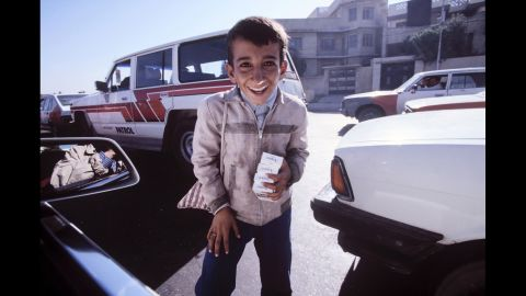 A boy begs for money in 1996. By then, Iraq was reeling under punishing international sanctions and widespread corruption.