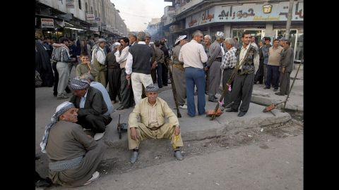 Kurds mingle with the crowds in central Mosul in 2002, just a few months before the U.S.-led invasion of Iraq.