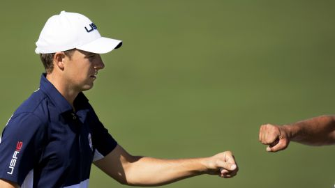 Team USA's Jordan Spieth fist bumps his caddy Michael Greller during the singles matches. He eventually lost to Henrik Stenson in a rare last day win for Europe.