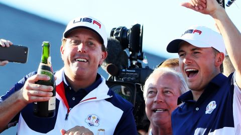 Phil Mickelson and Jordan Spieth of the United States celebrate with champagne after winning the Ryder Cup for their team.