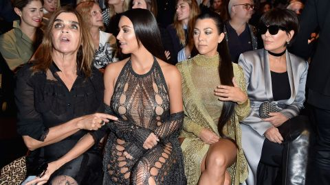 Kardashian West attends Paris Fashion Week with her sister and mother.