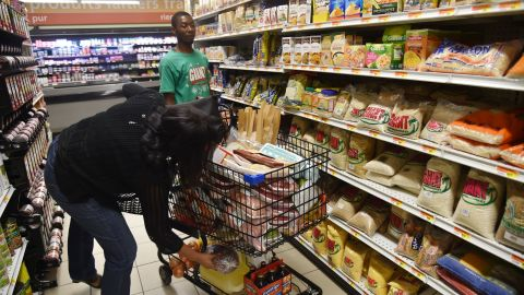 People stock up on food at a supermarket in Port-au-Prince on Sunday, October 2.