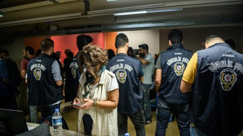 Turkish police officers in the offices of IMC TV station during a raid on October 4, 2016 in Istanbul.