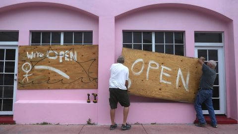 Kevin Forde and John Haughey put plywood on a Miami Beach window on October 6.