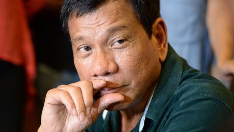 """Philippine President-elect Rodrigo Duterte speaks during his first press conference since he claimed victory in the presidential election, at a restaurant in Davao City, on the southern island of Mindanao on May 15, 2016. Duterte vowed on May 15 to reintroduce capital punishment and give security forces """"shoot-to-kill"""" orders in a devastating war on crime. / AFP / TED ALJIBE        (Photo credit should read TED ALJIBE/AFP/Getty Images)"""