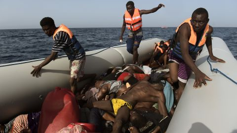 """Migrants step over dead bodies while being rescued in the Mediterranean Sea, off the coast of Libya in October 2016.  Agence France-Presse photographer Aris Messinis <a href=""""http://www.cnn.com/2016/10/06/europe/migrant-boats-libya-aris-messinis/index.html"""" target=""""_blank"""">was on a Spanish rescue boat</a> that encountered several crowded migrant boats. Messinis said the rescuers counted 29 dead bodies -- 10 men and 19 women, all between 20 and 30 years old. """"I've (seen) in my career a lot of death,"""" he said. """"I cover war zones, conflict and everything. I see a lot of death and suffering, but this is something different. Completely different."""""""