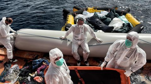 """Members of Proactiva Open Arms move the bodies of 29 migrants to a life boat. <a href=""""http://www.cnn.com/2015/08/28/world/iyw-migrant-how-to-help/index.html"""" target=""""_blank"""">How to help the ongoing migrant crisis</a>"""