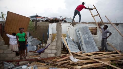 """Residents repair their homes in Les Cayes, Haiti, on October 6. <a href=""""http://www.cnn.com/2016/10/04/americas/hurricane-matthew/index.html"""" target=""""_blank"""">The damage from Hurricane Matthew</a> was especially brutal in southern Haiti, where sustained winds of 130 mph punished the country."""