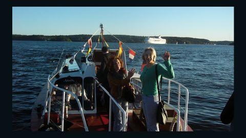 Anna Politkovskaya, right, and Tanya Lokshina on a boat headed from Stockholm in September 2006.