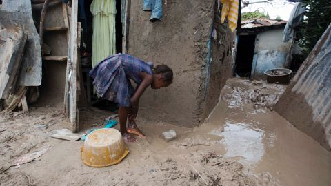 A girl washes mud from her feet after Hurricane Matthew passed through Les Cayes, Haiti, on October 6.