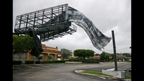 A billboard canvas flaps in the wind after Hurricane Matthew passed North Palm Beach, Florida, on October 7.