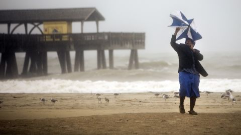 Preston Payne tries to hold his umbrella on Georgia's Tybee Island on October 7.