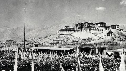 Tibetans gather during the armed uprising against Chinese rule on March 10, 1959, in front of the Potala Palace, the former home of the Dalai Lama, in Lhasa, the capital of Tibet.