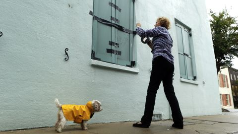 Barbara Hearst tapes her storm shutters as Hurricane Matthew nears Charleston, South Carolina, on October 7.