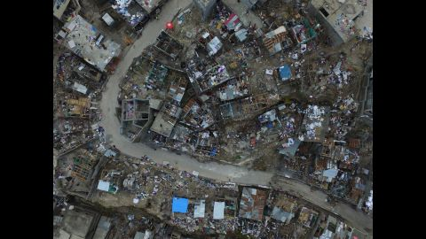 """An aerial view shows destruction caused by Hurricane Matthew in Jeremie, Haiti, on Friday, October 7. <a href=""""http://www.cnn.com/2016/10/04/americas/hurricane-matthew/index.html"""" target=""""_blank"""">The damage from Hurricane Matthew</a> was especially brutal in southern Haiti, where sustained winds of 130 mph punished the country."""