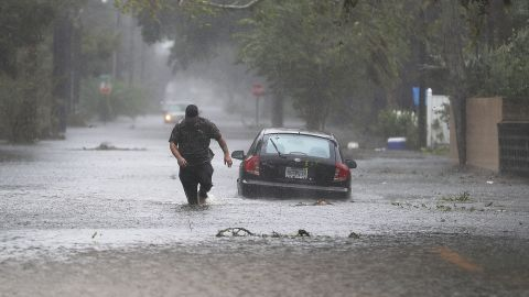ST AUGUSTINE, FL - OCTOBER 07: Justin Dossett walks through a flooded street as Hurricane Matthew passes through the area on October 7, 2016 in St Augustine, Florida. Florida, Georgia, South Carolina and North Carolina all declared a state of emergency in preparation of Hurricane Matthew. (Photo by Joe Raedle/Getty Images)