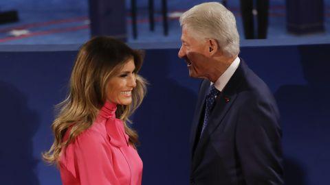 Melania Trump passes Bill Clinton after their handshake.