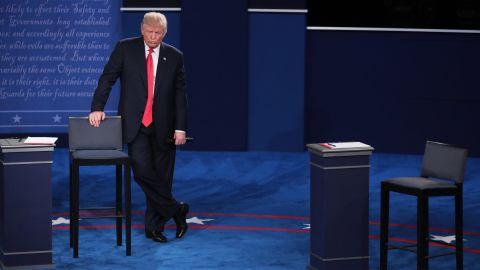 Trump leans against a chair during the debate.