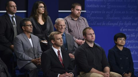 """Members of the audience listen to the debate. The 40 town-hall participants, selected by Gallup, were described as """"uncommitted voters."""""""