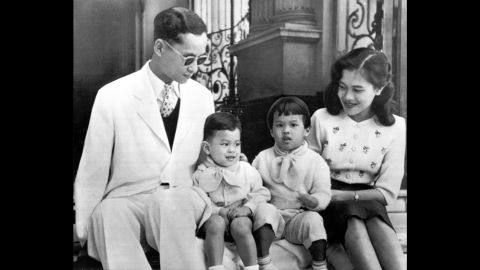 The King and Queen pose with their children, Crown Prince Vajiralongkorn and Princess Ubol Ratana, on the steps of Bangkok's Chitralada Palace in 1955. Two more daughters, Princesses Maha Chakri Sirindhorn and Chulabhorn Walailak, were born in 1955 and 1957.