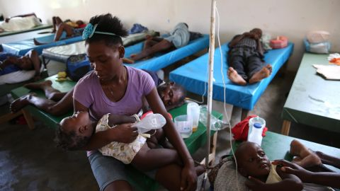 People sick with cholera receive medical assistance at a hospital in Jeremie on October 10. The destruction from Matthew has accelerated the cholera epidemic in Haiti and undermined strides made in fighting the waterborne disease, the country's leader says.