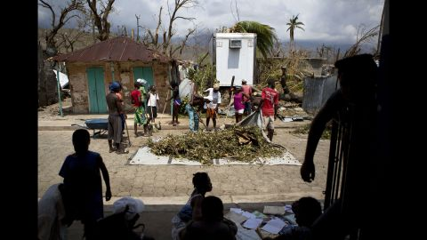 A group works to clear debris from the streets in Les Anglais on October 10.