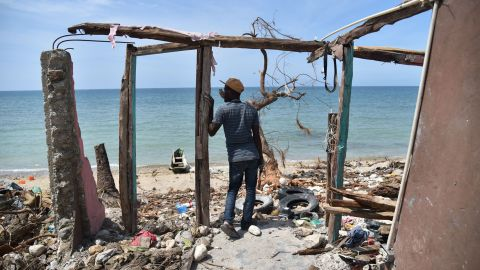 A man stands in the remnants of a house destroyed by Hurricane Matthew in the southern town of Les Cayes on Monday, October 10. Matthew wreaked havoc in Haiti, killing hundreds, destroying homes and knocking out electricity in the impoverished Caribbean nation. More than 1.4 million people are in need of urgent assistance, a UN official says.