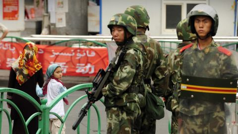 Chinese paramilitary policemen stand guard on a street in the Uighur district of Urumqi city, in China's Xinjiang region, on July 14, 2009.  A mosque was closed and many businesses were shuttered a day after police shot dead two Muslim Uighurs, as ethnic tensions simmered in China's restive Urumqi city. AFP PHOTO/Peter PARKS (Photo credit should read PETER PARKS/AFP/Getty Images)