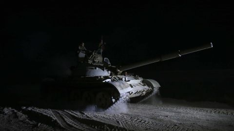Peshmerga forces deploy in the dark near the village of Wardak early on October 17.