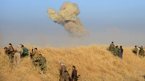 Smoke rises from a suicide car bomb attack carried out by ISIS in the village of Bedene on October 17.