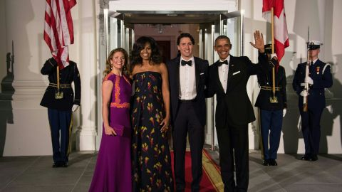 US President Barack Obama, Canadian Prime Minister Justin Trudeau and their wives Michelle Obama and Sophie Gregoire Trudeau pose upon the Trudeau's arrival for a state dinner at the White House on March 10, 2016.
