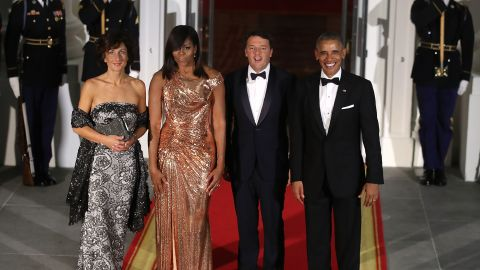 U.S. President Barack Obama and first lady Michelle Obama stand with Italian Prime Minister Matteo Renzi and his wife Mrs. Agnese Landini upon arrival for a state dinner at the White House, October 18, 2016 in Washington, DC.