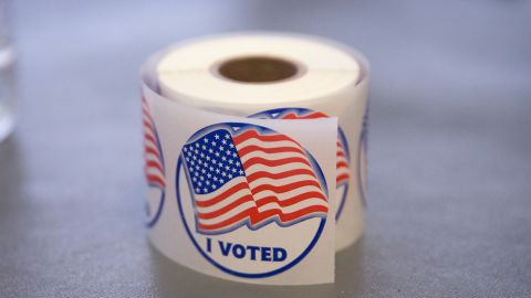 """A roll of """"I Voted"""" stickers, which are handed out to residents after they vote, sit on an election officials table at a polling place on November 4, 2014 in Ferguson, Missouri.  In last Aprils election only 1,484 of Ferguson's 12,096 registered voters cast ballots. Community leaders are hoping for a much higher turnout for this election. Following riots sparked by the August 9 shooting death of Michael Brown by Darren Wilson, a Ferguson police officer, residents of this majority black community on the outskirts of St. Louis have been forced to re-examine race relations in the region and take a more active role in the region's politics. Two-thirds of Fergusons population is African American yet five of its six city council members are white, as is its mayor, six of seven school board members and 50 of its 53 police officers.  (Photo by Scott Olson/Getty Images)"""