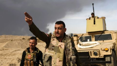 Iraqi forces head toward the front lines near Qayyara on Tuesday, October 18.