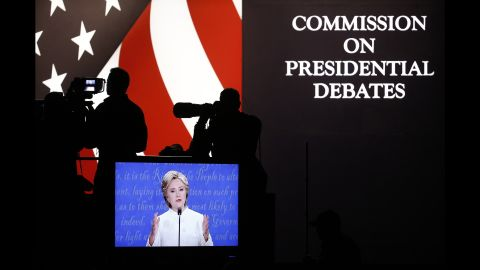 Clinton is seen on a television screen at the debate venue.