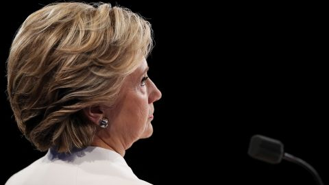 Democratic presidential nominee former Secretary of State Hillary Clinton listens to Republican presidential nominee Donald Trump speak during the third U.S. presidential debate at the Thomas & Mack Center on October 19, 2016 in Las Vegas, Nevada.