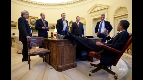 Obama speaks with aides in the White House Oval Office on February 4, 2009. From left are Senior Advisor Pete Rouse, White House Director of Legislative Affairs Phil Schiliro, Senior Advisor David Axelrod, National Economic Council Director Lawrence Summers and White House Chief of Staff Rahm Emanuel.