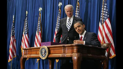 """Vice President Joe Biden watches Obama sign <a href=""""http://www.cnn.com/2010/POLITICS/02/17/economic.stimulus.2010/"""" target=""""_blank"""">the economic stimulus bill</a> on February 17, 2009. The goal was to stimulate the country's staggering economy by increasing federal spending and cutting taxes."""