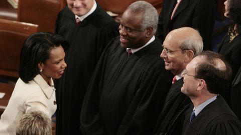 Thomas stands next to Supreme Court Justice Samuel Alito as Alito shakes hands with Secretary of State Condoleezza Rice prior to the State of the Union speech in January 2006.