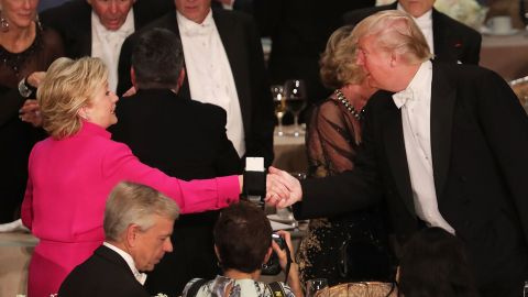 Hillary Clinton shakes hands with Donald Trump while attending the annual Alfred E. Smith Memorial Foundation Dinner at the Waldorf Astoria on October 20, 2016 in New York City.