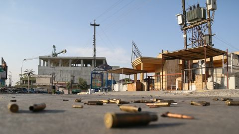 Spent bullet cartridges litter the street around the Jihad Hotel, where ISIS militants battled Iraqi security forces in Kirkuk on Friday, October 21.