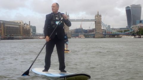 In London Andy Mitchell, the CEO of Tideway Tunnel, a sewer project for the River Thames, is pictured paddle boarding in front of the city's historic Tower Bridge.