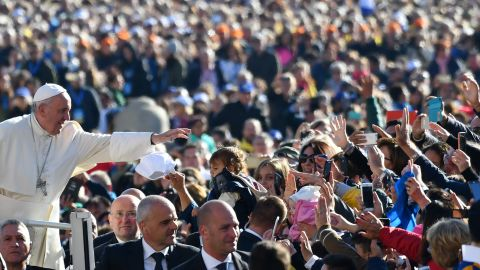Pope Francis salutes the faithful upon his arrival in St. Peter's Square at the Vatican for the Special Jubilee Papal Audience on Saturday, October 22, 2016.
