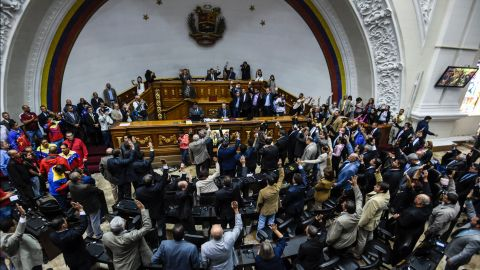 """Opposition deputies raise their hands while voting to open a political trial against President Nicolas Maduro. A majority of lawmakers voted in favor of a motion to launch a """"political and criminal trial"""" after his government blocked their drive for a referendum on removing him."""