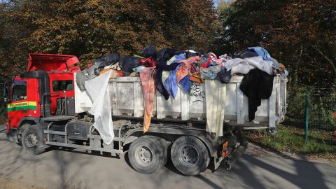 """Migrants' belongings are trucked out of the """"Jungle"""" on October 25."""