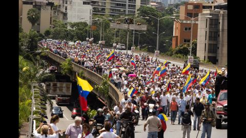 Opponents of President Nicolas Maduro's government, led by Lilian Tintori, wife of imprisoned opposition Leopoldo Lopez, gather to protest the suspension of the recall referendum.