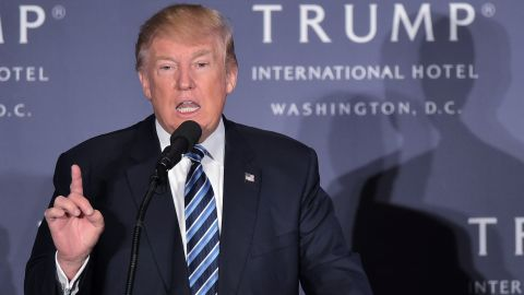 Republican presidential nominee Donald Trump speaks during the grand opening of the Trump International Hotel in Washington, DC on October 26, 2016. / AFP / MANDEL NGAN        (Photo credit should read MANDEL NGAN/AFP/Getty Images)
